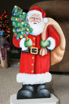 """15x10"""" Hand painted Santa Claus with his bag of goodies and a decorated Christmas tree on wood with a stand by sherrylpaintz."""