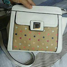 NWT Jessica Simpson Crossbody Confetti & White Gorgeous Crossbody bag by Jessica Simpson Brand new with tags  One side white and the other side tan with confetti colorful dots!  Silver hardware. Jessica Simpson Bags Crossbody Bags