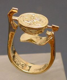Ring: 14 kt gold, Cast 14 kt Byzantine Scarab: Boy on a Dolphin.