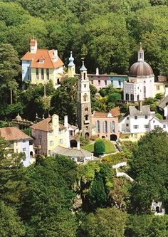 Wales - Portmeirion is a popular tourist village in Gwynedd, North Wales. It was designed and built by Sir Clough Williams-Ellis between 1925 and 1975 in the style of an Italian village and is now owned by a charitable trust. Great Places, Places To See, Places To Travel, Beautiful Places, Amazing Places, Wonderful Places, Wales Uk, North Wales, Snowdonia