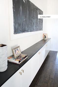 Ikea Hack floating shelves. Love the black, white, brass combo