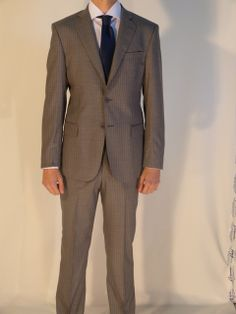 Grey wool PINZANI suit super 110's. Two vents, two buttons, pick stitching and working cuffs.  Visit www.pinzani.biz to find out more.
