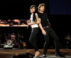 Amy Winehouse performs with Mick Jagger at the Isle of Wight Festival in Newport, England, June 10, 2007.