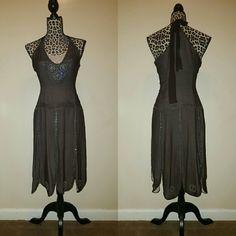100% Silk Gatsby Dress Size 6 Gatsby beaded dress. This dress is dark brown  no stretch. 100% silk, zips on the side. New never worn, no tag Dresses Midi