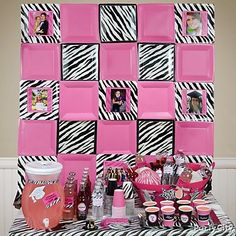 Pink and zebra grad party backdrop made with square plates and pix of the grad!