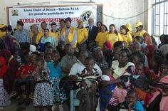 Lions pose with Parents who came for the Immunization Awareness Talk at the Mukuru Educational Centre.