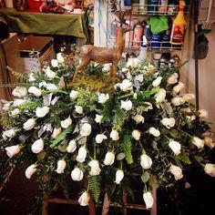 Deer White Rose Casket Spray Designed by Max's Flower Shop