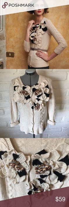 Anthropologie Yellow Bird Dimensional Petal Cardi Anthropologie Yellow Bird Dimensional Petal Cardigan is a soft oatmeal color. Petals are oatmeal and black color with clear, tan and brown beads. Very soft and comfortable sweater is in very good used condition. No flaws or damage but normal signs of minimal wear. 90% wool, 10% alpaca. Buttons up the front. Laid flat the bust measures 18 inches unstretched. Length from shoulder down is approximately 24 inches. Size medium fits true to size…