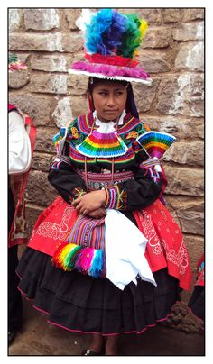 On Isla Taquile, located in Lake Titicaca, some 2000 people live quite isolated from the mainland. Because the proud islanders maintain a colourful lifestyle, every day many tourists make the trip to the island.  The woman on the picture is one of the members of a dance ensemble to entertain the tourists. Elevation 500 feet above the lake.