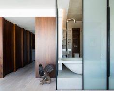 A cast concrete bathtub, a walnut-lined office and translucent walls that move at the touch of a button all feature inside this renovated London apartment by The Klassnik Corporation