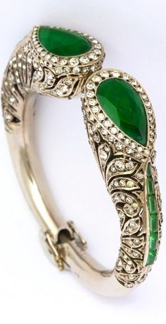 "1920s Elegant Art Deco French Paste Bracelet.  A grand piece of 1920s Art Deco ""traveling jewelry"" made in the style of fine jewelry. A silver and French paste bracelet imitating diamonds and emeralds. Spring closure, with 2 original safeties. French silver and maker marks. Completely closed fits a 6 1/2 inch wrist. Excellent condition."