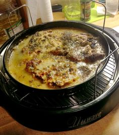 NuWave Oven Recipe   3 pork chops, frozen  1 can mushroom soup  1 pkg. french onion soup mix  2 cups water poured over chops    Directions:    1.Mix all ingredients together in baking pan.  2.Place pan on 1-inch rack.  3.Cook on Power Level HI for 10 minutes.  4.Cook on Power Level 9 for 45 minutes.