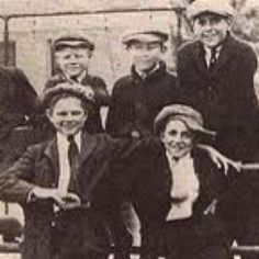 Walt Disney, center right, as Kansas City Star paper boy