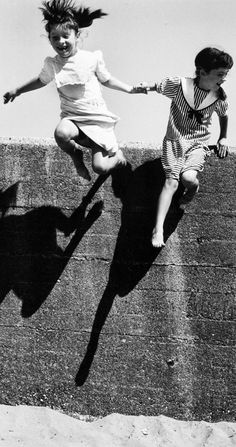 A leap of faith on Tory Island off the northwest coast of County Donegal in Ireland (1995) • photo: Martine Franck on Magnum Photos // Black and White Photo
