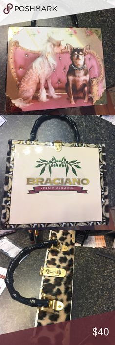 "Cigar box purse  Dog  print with rhinestones on one side and cigar box logo on other side--edges covered with faux leopard fur and inside pocket as well. Fake bamboo look handle and gold closure accents. INSIDE Box is 9"" in width and 7"" length and 2"" in depth!  SUPER CUTE!!!! Bags"