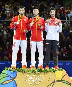 #RIO2016 China's table tennis singles gold medalist Ma Long and silver medalist Zhang Jike stand alongside Japan's bronze medalist Jun Mizutani on the podium...