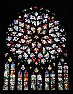 It was begun in 1140 and belongs mainly to the 12th century, but was not complete until early in the 16th century. The architecture of its choir influenced, through the architect William of Sens, that of the choir of Canterbury Cathedral.  The Rose WIndow depicted is a symbol of what all French Gothic Cathedrals embraced: stained glass depicting scences from the scripture.  Rose Windows were the structure erected above the entrance ways on Gothic structures.