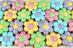 Our Spring Flower Pretzel Bites are so pretty and so easy to make. Sweet, salty, crunchy and delicious - what a great Easter Dessert. Your guest will beg for more of these colorful Easter Treats. They would also be a great homemade Mother's Day Dessert and Spring treat. Follow us for more fun Easter Food Ideas. #EasterDesserts #EasterTreats #EasterFood #FlowerPretzelBites