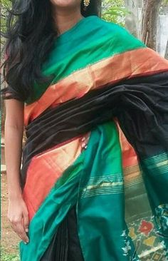 Black ikkat silk saree with green borders and patola pallu