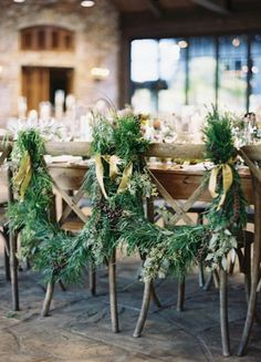 Pine boughs set the bride and groom's chairs apart during a winter wedding.
