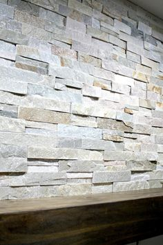 How to install stacked stone tile on a fireplace wall from Thrifty Decor Chick Stone Tile Fireplace, Tile Around Fireplace, Tall Fireplace, Shiplap Fireplace, Fireplace Hearth, Home Fireplace, Fireplace Remodel, Fireplace Design, Fireplace Surrounds