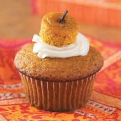 "These pumpkin cupcakes are so cute! I love how the clove is the ""stem"" of the pumpkin!!"