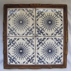 """Up for your consideration is this beautiful DAL-TILE Trivet set in Hand carved Wood frame from Mexico that will will enhance the beauty of any table or decor. Tiles are white with blue design frames in natural carved wood . This lovely piece measures: 9 1/4"""" square. No cracks chips for crazing to tile. Light wear but nothing significant to the wood frame. 