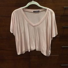 brandy Melville pink v neck crop tee super cute and flowy. it's so soft and a nice light pink color. no trades. will sell for cheaper on ♏️ Brandy Melville Tops