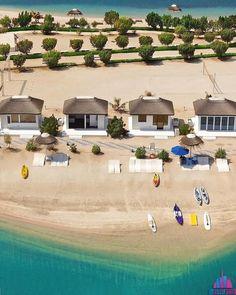 Beautiful view of the Island Dubai, located in Dubai's iconic World Islands. #royalislandbeachclub #beachclub #theislanddubai #worldislanddubai #lebanonisland #privatebeach #thatch #thatching #thatchedroofs #skyline #capereed #dubai #mydubai #uae Timber Structure, Luxury Cabin, Group Of Companies, Island Beach, Beach Club, Cabana, New Construction, Uae, Islands