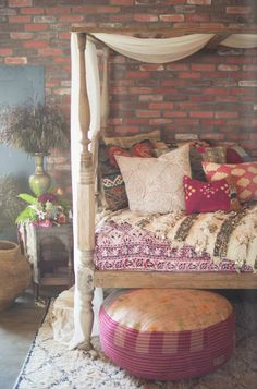 50 Dreamy Boho Bedroom Decorating Ideas - The distressed wood of the rustic four-poster bed speaks stories of bygone days, while the ethnic scatter cushions and tuffet bring a strong hippy sensibility to this lovely room. Dream Rooms, Dream Bedroom, My New Room, My Room, Deco Boheme, Room Inspiration, Bedroom Decor, Canopy Bedroom, Bedroom Seating