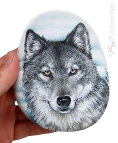 A wild wolf painted on a flat sea rock | Rock painting #art by @robertorizzoart…