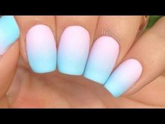 Pink and blue ombre nails done with a sponge and nails
