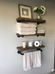 The wood is stained in Special Walnut to give it that rustic look. Add style and appeal to your bathroom! These roomy shelves hold plenty of bath essentials while firmly mounted bar holds towels at ready reach. Hang Towels In Bathroom, Floating Shelves Bathroom, Rustic Floating Shelves, Small Bathroom Storage, Wood Shelves, Industrial Shelves, Small Bathrooms, Master Bathrooms, Shelving In Bathroom