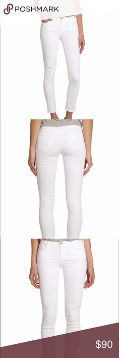 "J BRAND 811 Mid-Rise Skinny Feather-light stretch jeans shaped in a skinny silhouette Belt loops Zip fly with button closure Five-pocket style Rise, about 8"" Inseam, about 30"" Leg opening, about 5"" Cotton/polyester/spandex J Brand Jeans"
