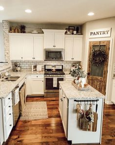 Home Remodeling White Cabinets Farmhouse kitchen Vintage style Cottage style White kitchen White cabinets Faux brick Spring farmhouse kitchen Modern Farmhouse Kitchens, Farmhouse Kitchen Decor, Kitchen Redo, Home Decor Kitchen, New Kitchen, Home Kitchens, Farmhouse Remodel, Vintage Kitchen, Awesome Kitchen