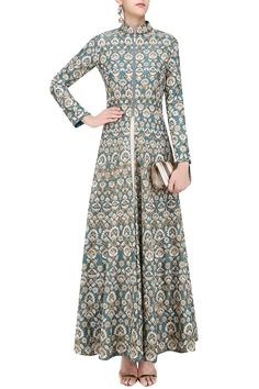a teal color long flared high neck jacket anarkali in raw silk base embroidered with gold and ivory floral resham thread work all over the front, back and sleeves. It has zipper closure detailing on centre front. It comes along with beige georgette inner.
