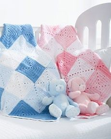 Follow this free crochet pattern to create a double diamond blanket using Bernat Softee Baby Sport yarn.