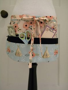 These aprons are perfect for the classroom, art/craft show booth, food booth, tool room/shed or any use around the home or workplace. They are made of all 100% cotton fabrics and feature 8 pockets, including one pocket with a zipper closure and a swivel key holder. Measurements: