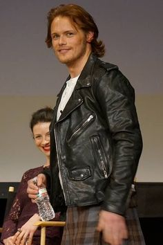 Sam Heughan and Caitriona Balfe in the background
