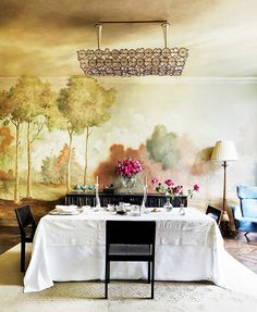 10 Celebrity Dining Rooms You'll Love // The muraled dining room in fashion designer Stefano Pilati's Paris duplex, painted by Mathias Kiss and Olivier Piel of Atelier Attilalou, is an absolute dream. Our meals would never end if we called this place home.