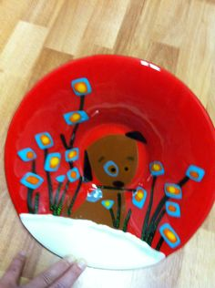 fused glass, puppy in flowers