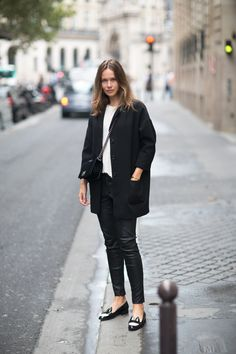 Coat from Topshop, tee from Caroline Blomst, leather pants from Gina Tricot, bag from Chanel, loafers from Minna Parikka.