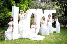 www.thelovesign.com.au One of my favourite ever photos! I love the contrast of the white and green! And love love love the grace loves lace dresses! Contact us for a quote today!