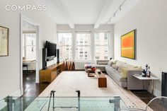 This spacious, beautifully-designed two bedroom two and a half bath condominium is hard to resist if luxury living near Gramercy Park is your hearts desire. Dramatic high ceilings, gorgeous walnut stained oak floors, double-paned windows, generous closet space, and a washer/dryer are other wonderful highlights of this very special, very large 1340 square foot residence. The expansive living/dining area with triple windows and chic open stainless chefs kitchen with a Viking Range, Su...