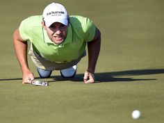 Germany's Maximilian Kieffer lines up a put on 9th green during the Nordea Masters golf tournament at the PGA National golf course outside Malmo, Sweden.  TT News Agency via Reuters