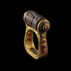 Gold & Ruby Seal Ring  --  Mesopotamian  --  Photo courtesy of Galerie Golconda.