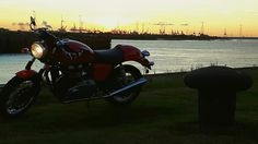 My Triumph Thruxton 900, sunset at the port of Antwerp