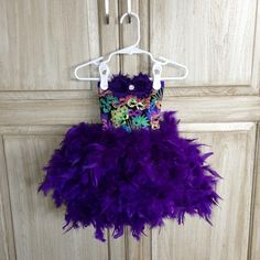 Feather Dress Peacock Feather Tutu Dress Mardi Gras Feather Party Dress - Peacock Toddler Infant Birthday Pageant Dress. $115.00, via Etsy.