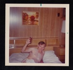 Old Vintage Photograph Shirtless Man in Underwear in Bed Holding Can of Soda Up