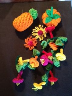 Flowers and fruits made for the Artisphere Yarn Bomb by two talented artists in fiber! Includes a pineapple, a pumpkin, echinacea blossoms (coneflower), and a trumpet vine. Yarn Bombing, A Pumpkin, Trumpet, Blossoms, Vines, Pineapple, Crochet Necklace, Gardens, Artists